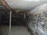 Masonry Repair Needed Limestone Basement Foundation Walls (Before Photo)